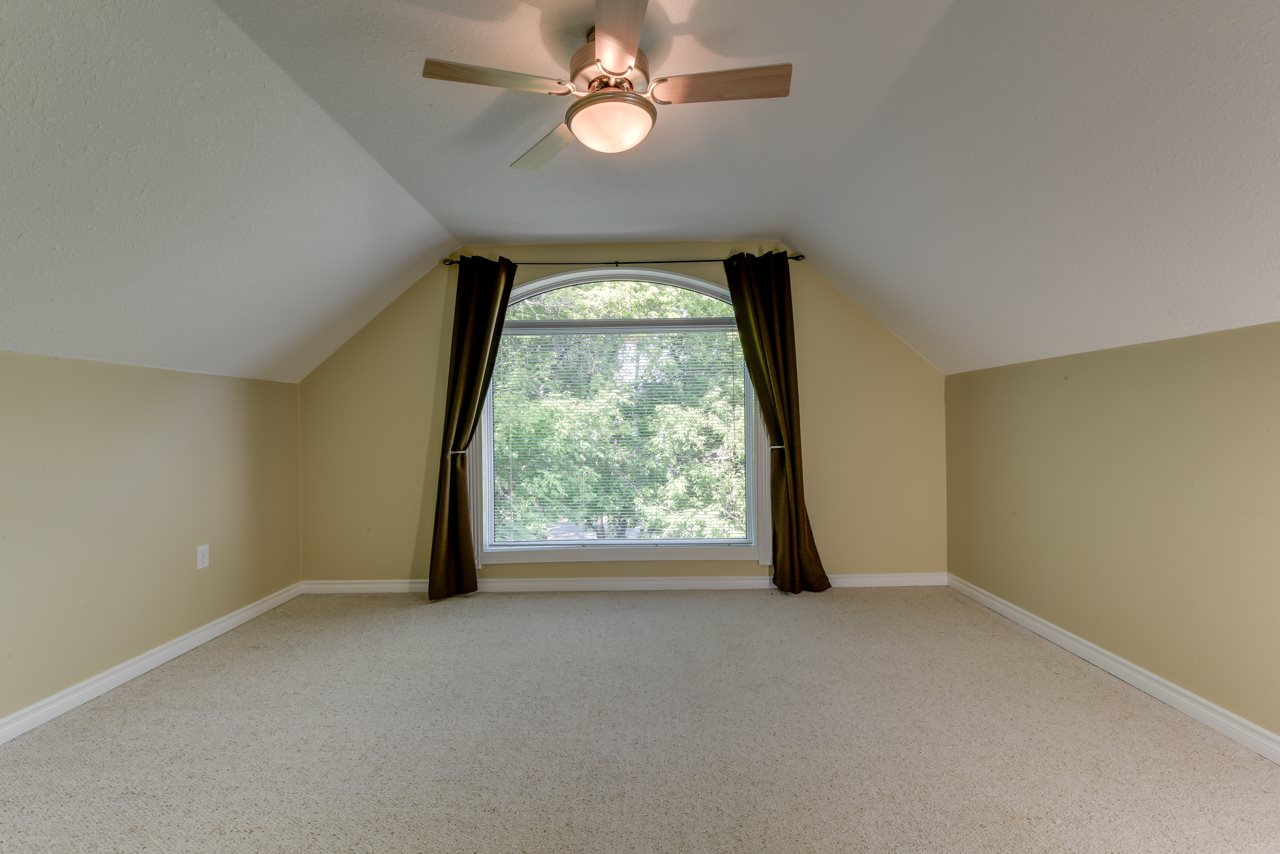 2nd upstairs spare bedroom with cathedral window looking out into the treetops! Could also make a fantastic studio/office.