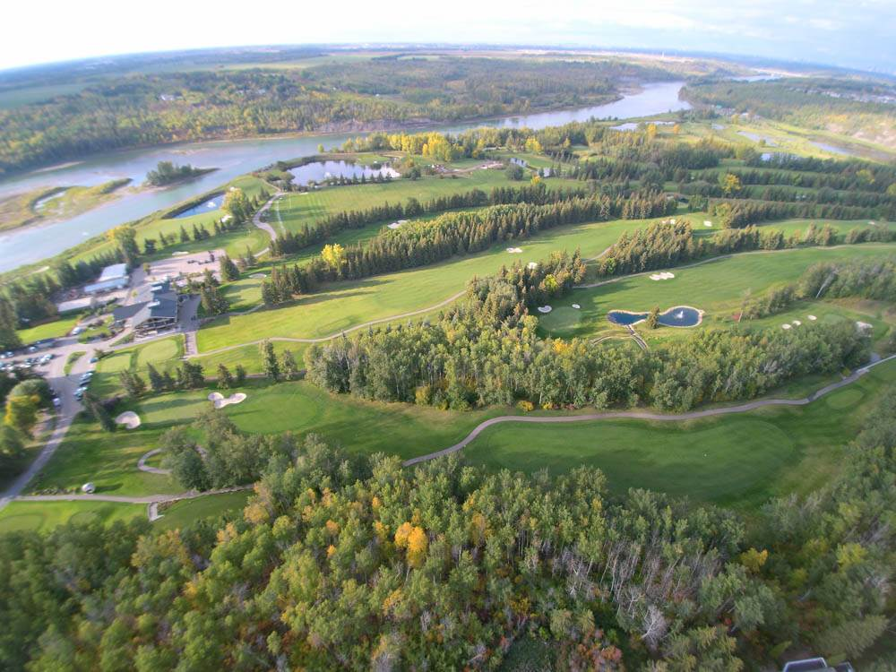 Aerial view of the beautiful Windermere Golf & CC. This property overlooks this golf course and river valley.