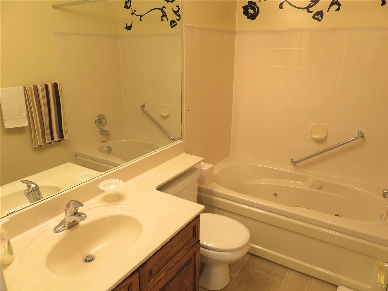 View of the main 4pc Bathroom with a JACUZZI TUB!
