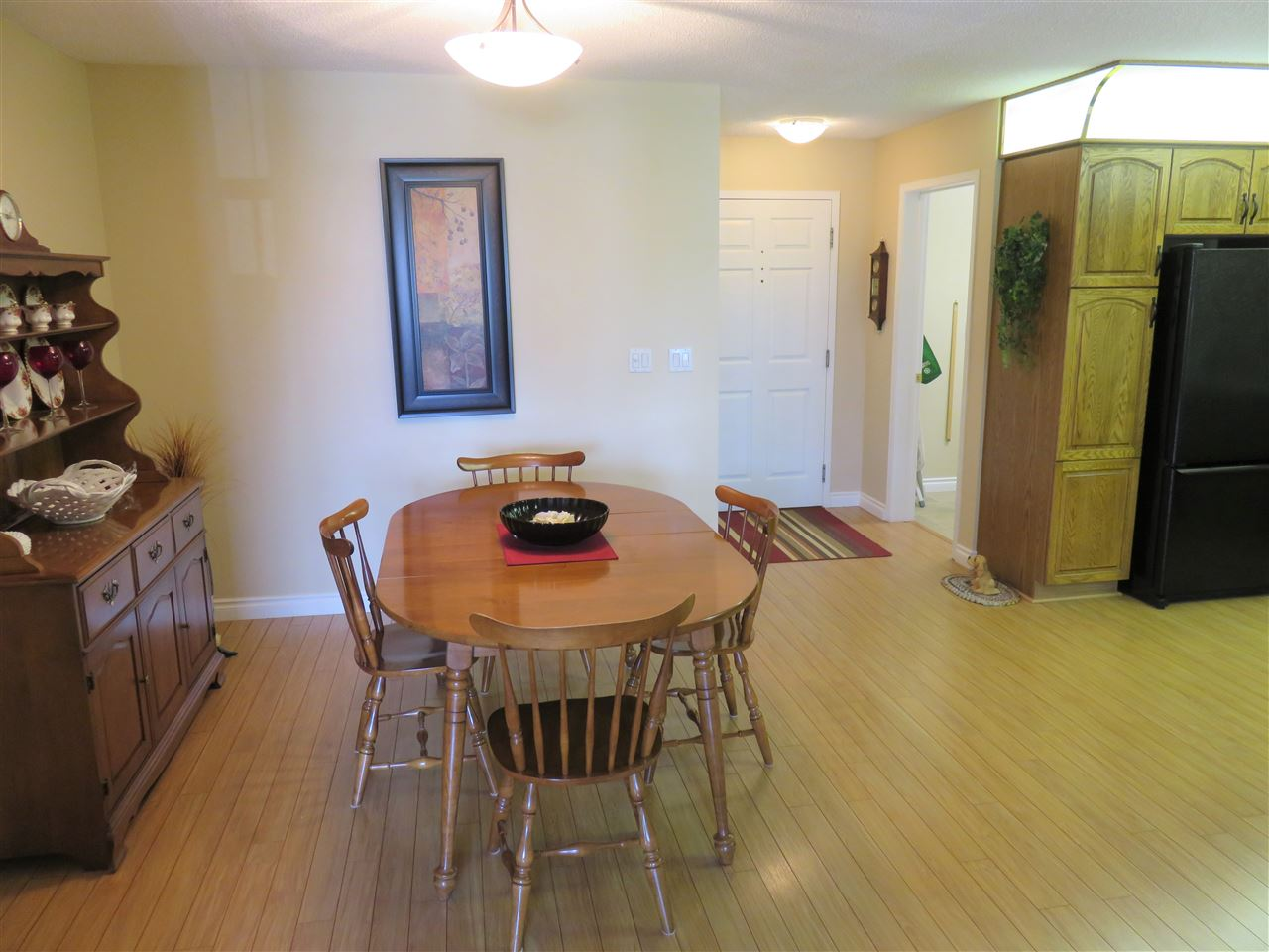 Another view of the Dining Room looking towards the entrance door & Laundry Room! :)