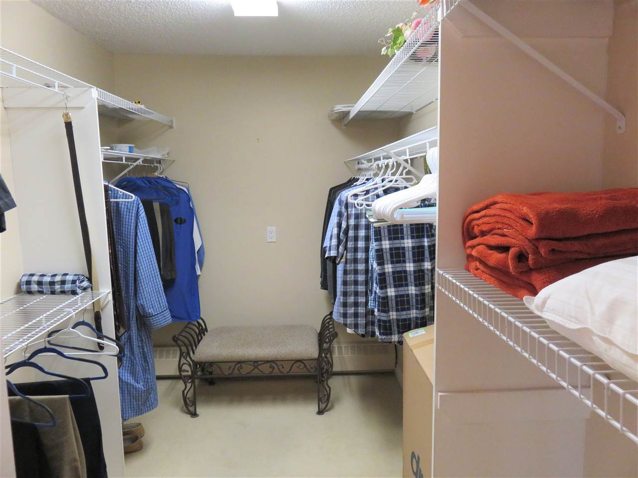 View of the oversized Master Bedroom Walk-In Closet! Plenty of room for you both?! lol..