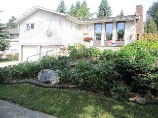 The variety of perennials (lilies, tire lilies, peony, hens and chick, lily of the valley, lupines, cover plants, evergreen shrubs, along with large rock and cedar mulch adds to the beauty of this landscaping