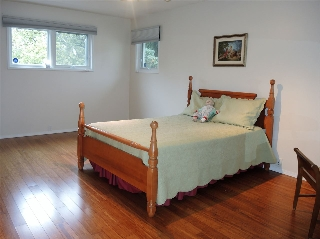 Spacious master bedroom with a walk in closet and ensuite - flooring upgraded in 2012