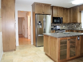 Kitchen appliances upgraded to stainless steel and flooring in 2012