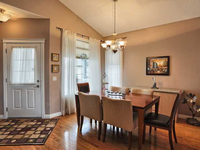 Formal dining area, which has high vaulted ceilings, hardwood flooring and plenty of space for your furniture
