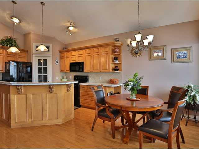 View of the kitchen and breakfast nook.  This home benefits from lots of natural light flooding through windows