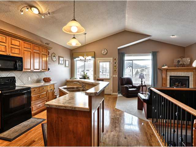 Hardwood flooring, upgraded kitchen appliances, vaulted ceilings.