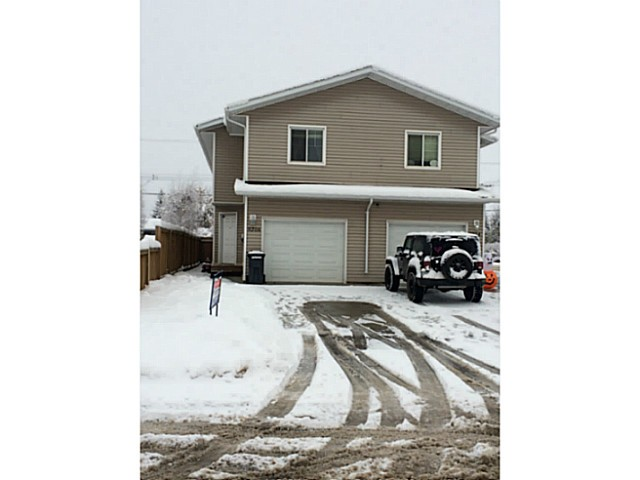Main Photo: 9206 103RD Avenue in Fort St. John: Fort St. John - City NE House 1/2 Duplex for sale (Fort St. John (Zone 60))  : MLS(r) # N240719