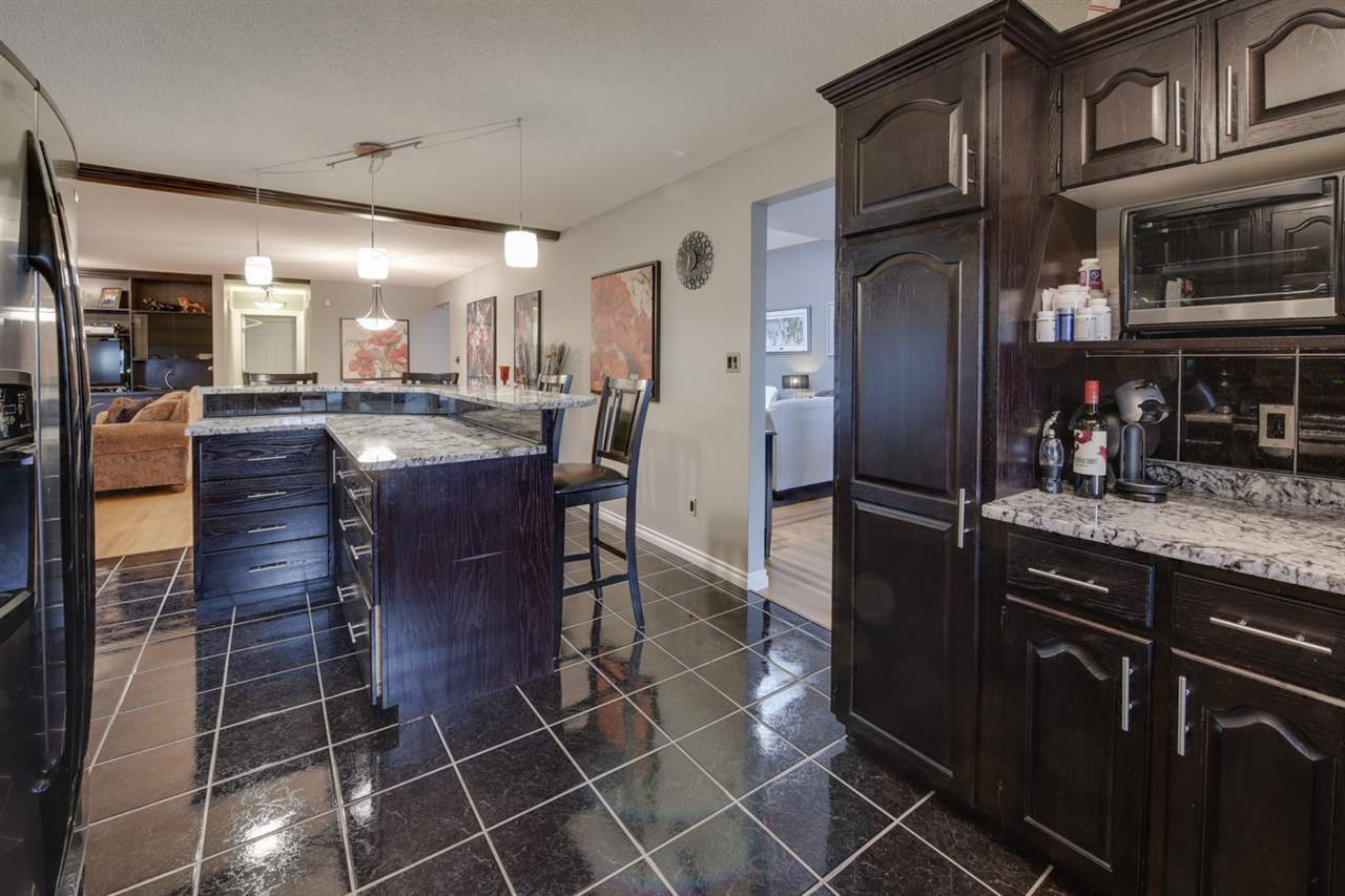 Huge island with breakfast bar, granite counters and stainless steel appliances