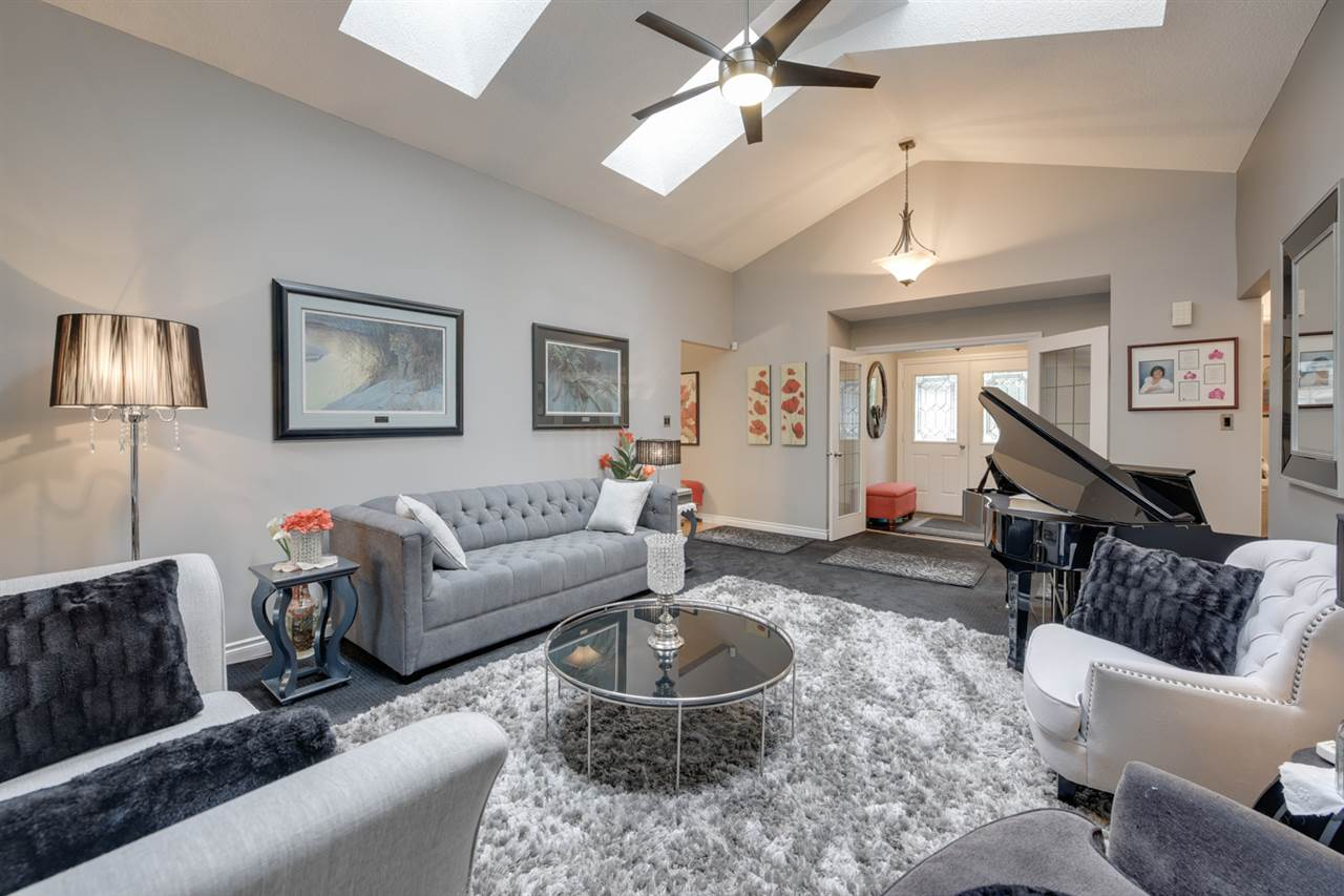 Vaulted ceilings, hardwood flooring and open flow in this livingroom