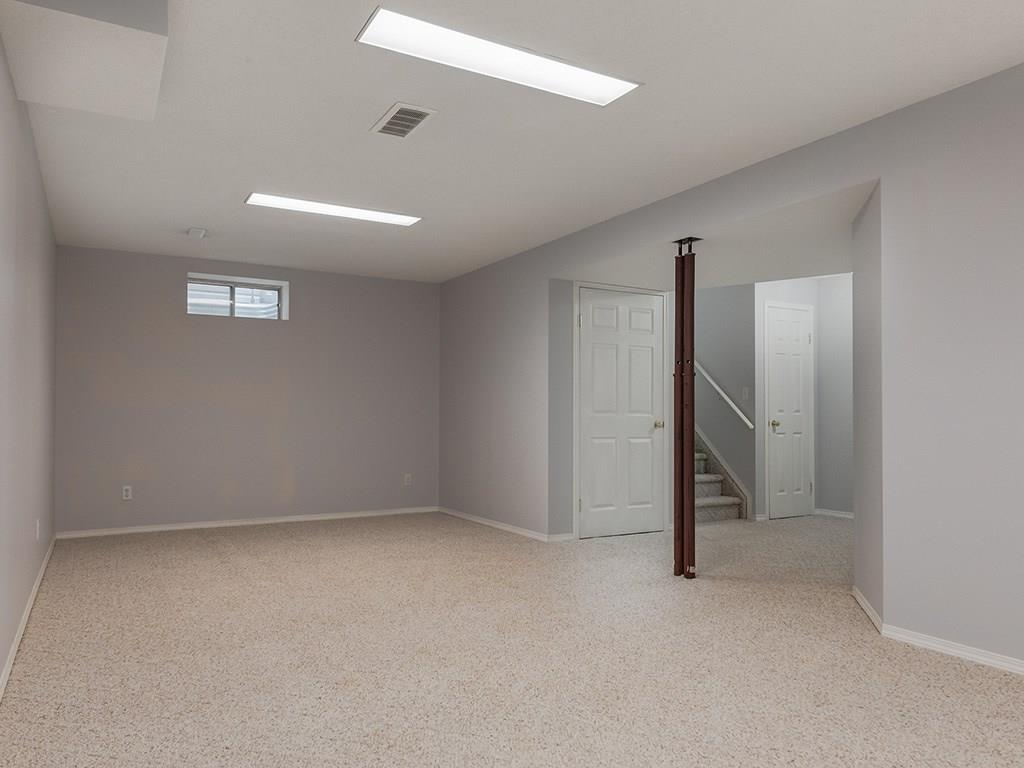 Large rec room in basement with storage areas
