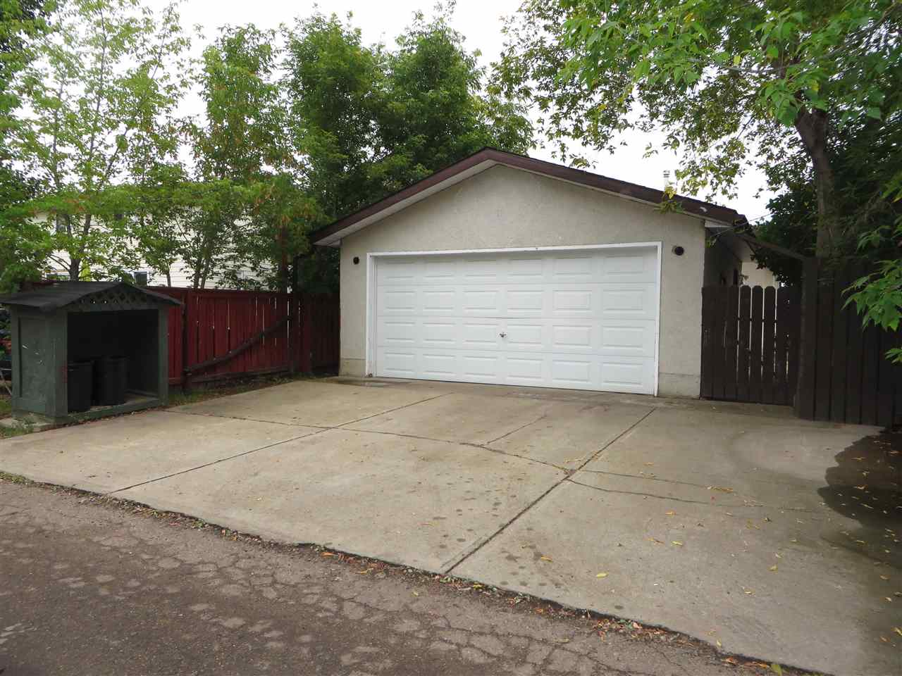 full size double garage with extended driveway for additional parking
