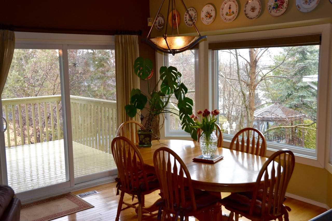 There IS a formal dining room as well as the eating area off the kitchen.