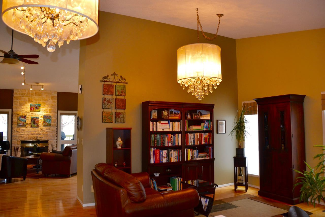 The main floor living area is quite open with very impressive high ceilings, hardwood floors & a welcoming feel.