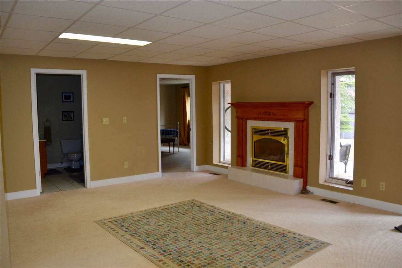 The walkout basement offers loads of natural light. The rec room is huge with doors opening out to covered patio.