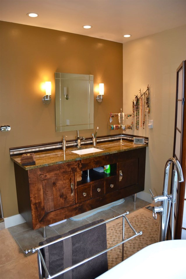 There's a soaker tub, big shower, heated floors and granite counter.