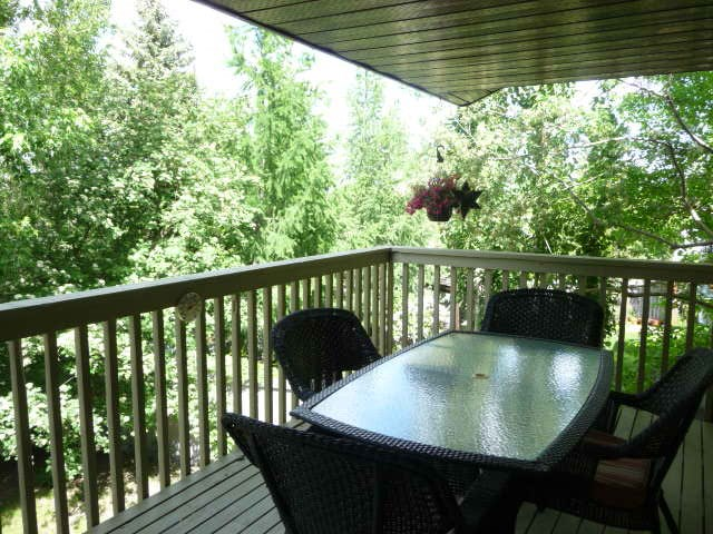 There is a large covered deck off the family room and master bedroom. You will appreciate the view from here.