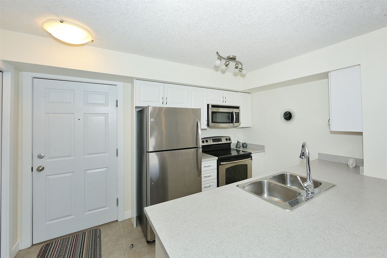 The kitchen has full size stainless appliances, including a new dishwasher!