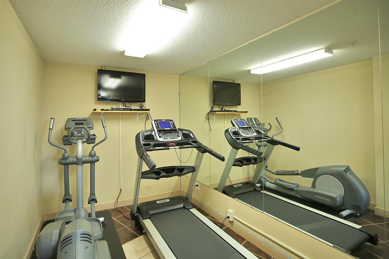 The gym area includes an elliptical, treadmill and weight bench/weights! (Access included in your low condo fees)