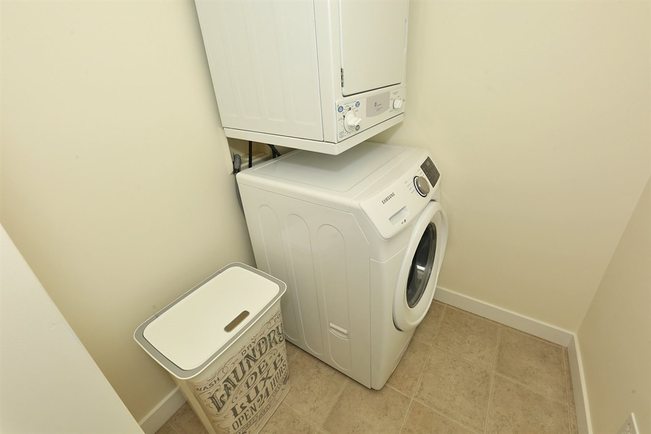 Bigger than it looks! The laundry area is a perfect spot for your laundry needs, and provides additional storage space too! (over-sized pantry items?!) PLUS, new washing machine!
