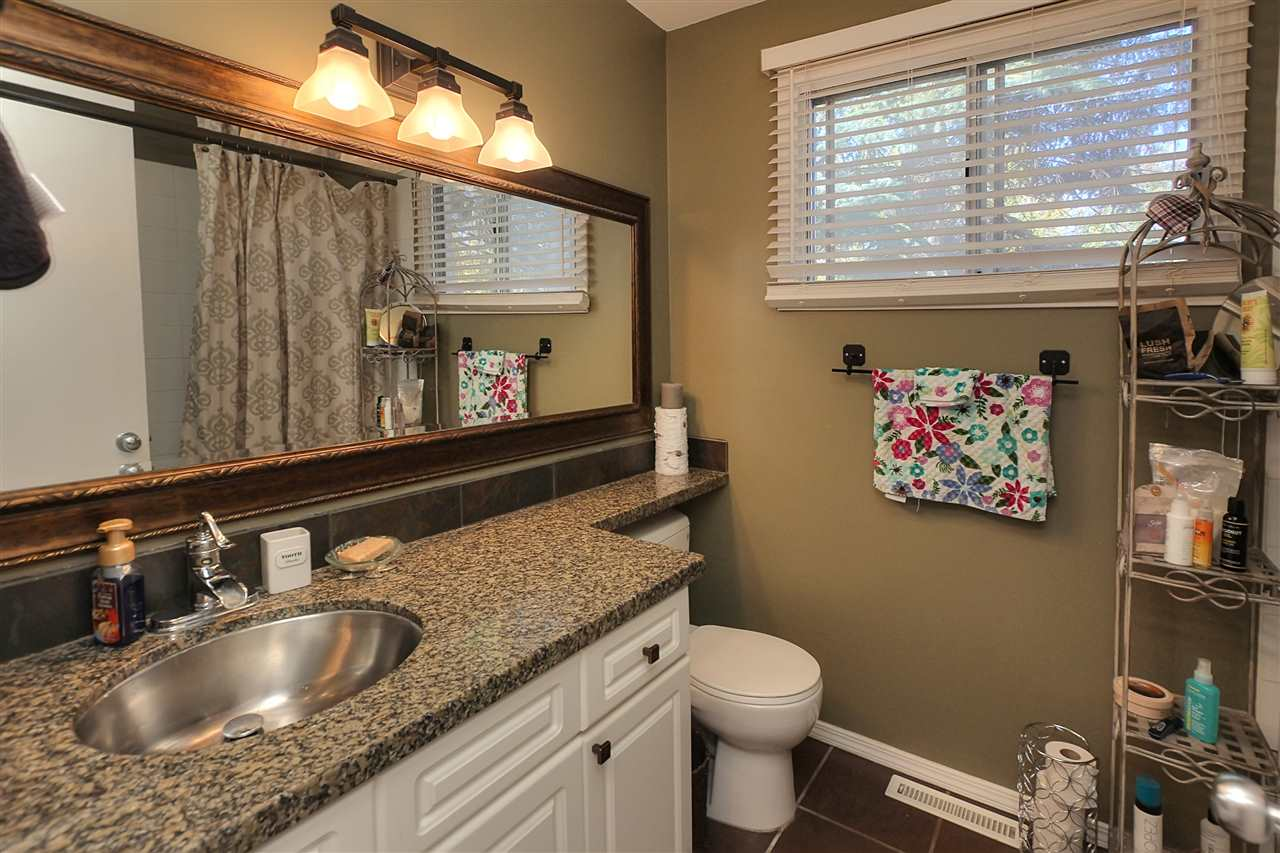 The main bathroom upstairs has not only some extras you won't expect.. like a stainless steel sink in the granite counter top, but you will love the deep soaker tub.