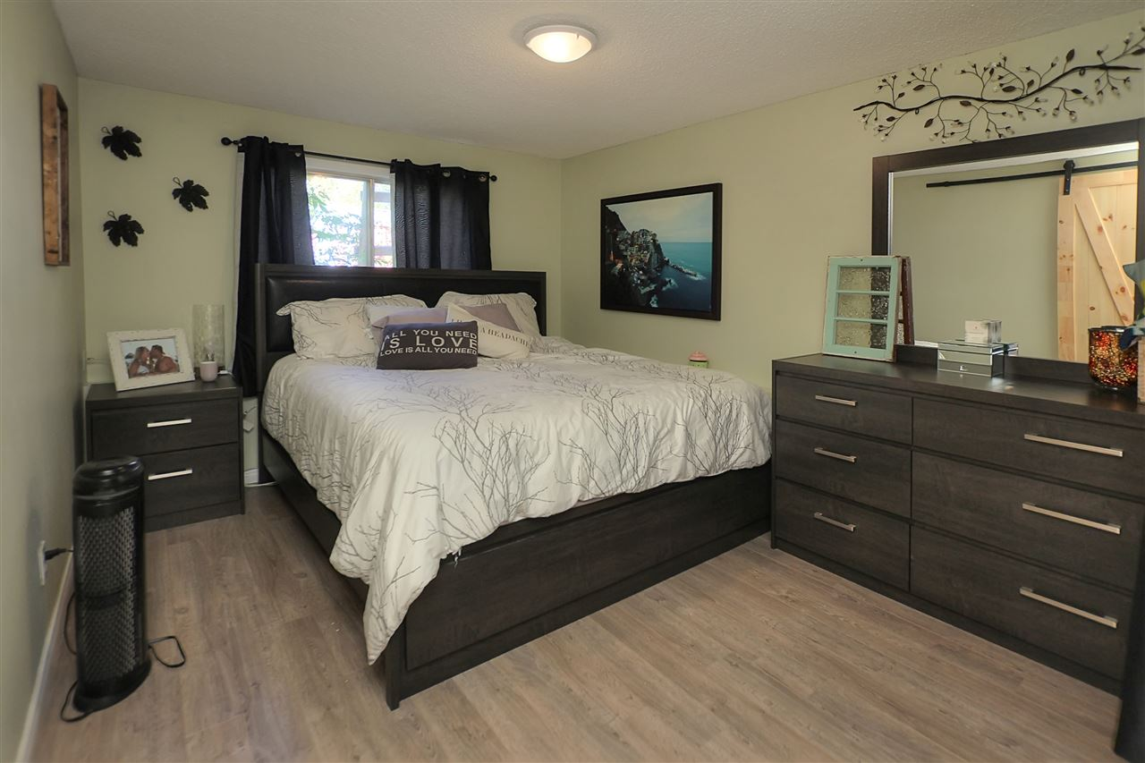 The Master bedroom is on the main floor at the back of the home down a small hallway from the living room. The room is large and has an en suite bathroom that has a barn door entrance where you will find a 3 piece bath with shower.
