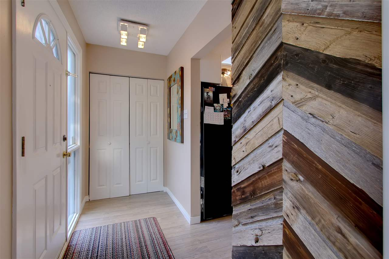 The new barn wood feature at the space by the entranceway leading into the kitchen and dining room adds a trendy touch to the home.