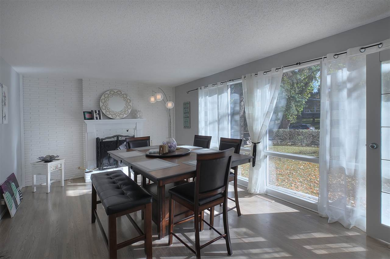 The current dining room makes a great impression for formal dining or entertaining. If you prefer, this could be the formal living room or even a play room if you have small children. There is a fireplace here also. The wall of windows add fabulous light.