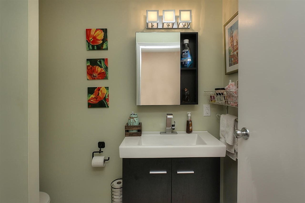 The three piece bathroom off the Master bedroom also has a door from the hallway. There is a barn door into the Master.