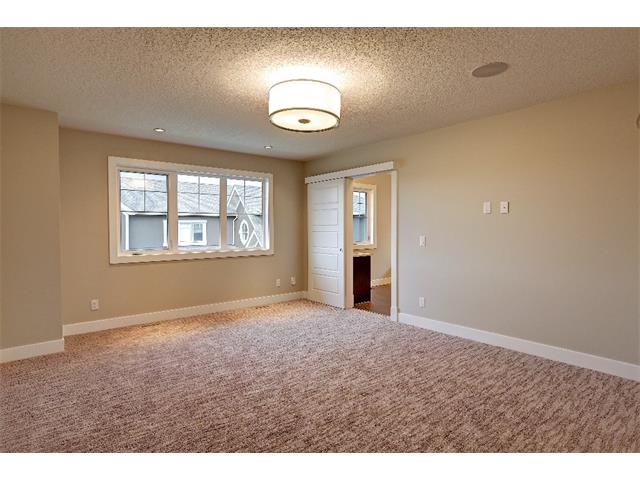 Photo 20: 71 ASPEN CLIFF Close SW in Calgary: Aspen Woods House for sale : MLS(r) # C4013616