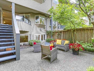 "Main Photo: 2411 W 1ST Avenue in Vancouver: Kitsilano Townhouse for sale in ""Bayside Manor"" (Vancouver West)  : MLS(r) # R2191405"