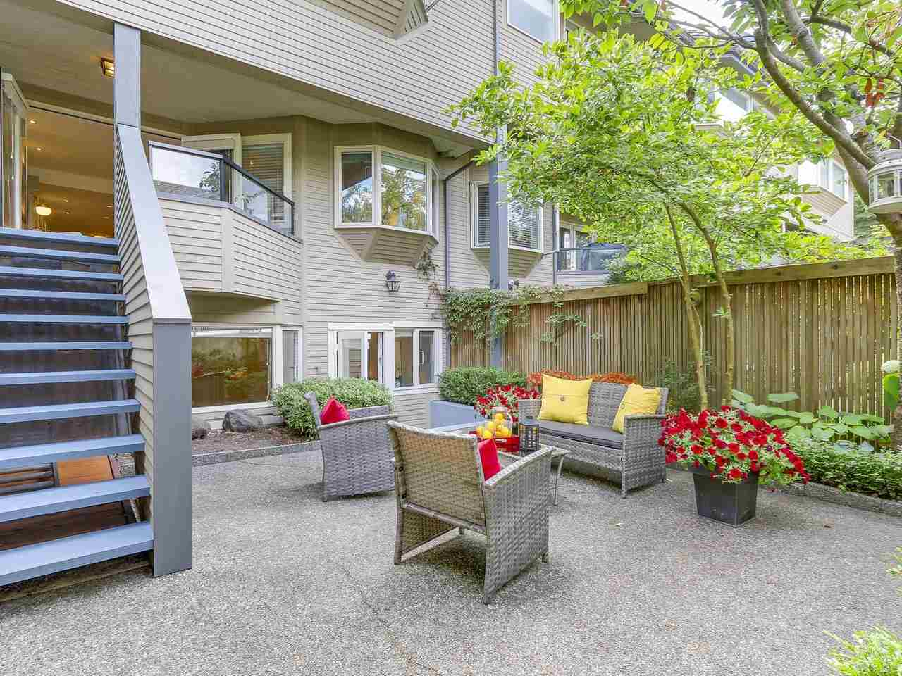 "Main Photo: 2411 W 1ST Avenue in Vancouver: Kitsilano Townhouse for sale in ""Bayside Manor"" (Vancouver West)  : MLS® # R2191405"
