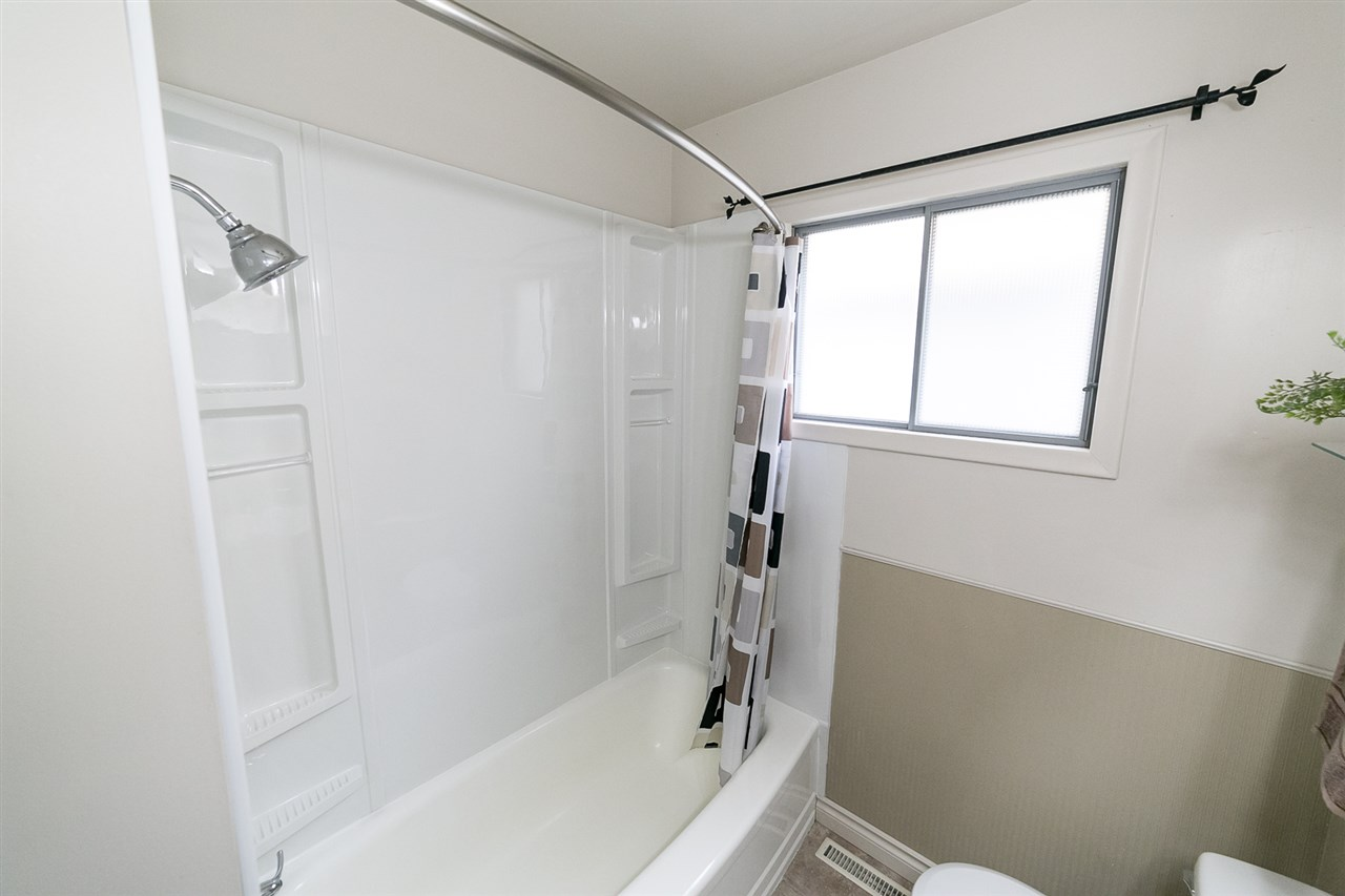 This inviting bathroom also has a new tub surround.