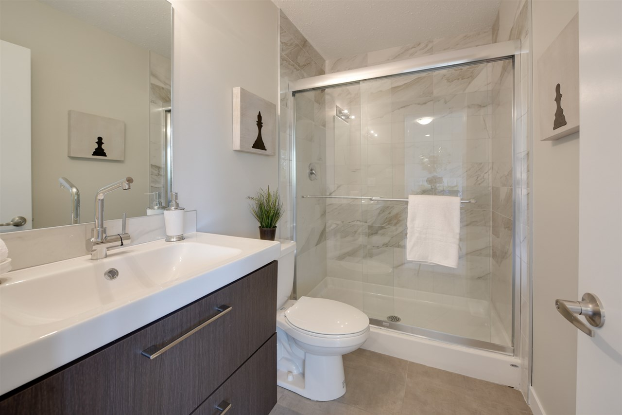 Fresh ensuite, complete with large tiled shower and vanity.