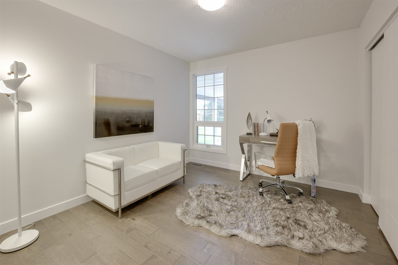 Main floor bedroom with window view of the front of the property - great for an extra room or a fantastic home office!