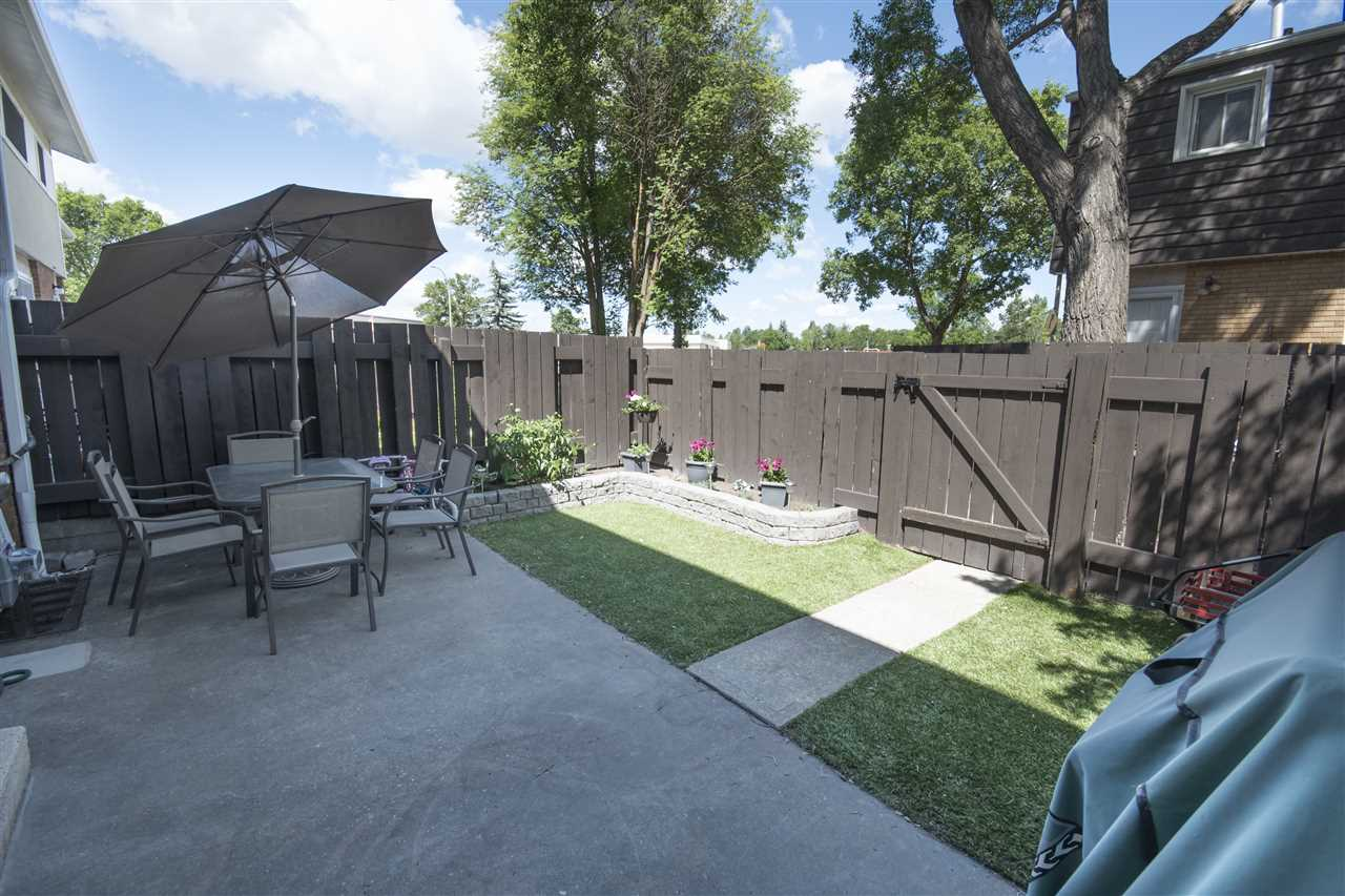 Concrete pad and artificial grass for year round enjoyment!