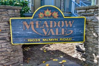 "Main Photo: 53 19034 MCMYN Road in Pitt Meadows: Mid Meadows Townhouse for sale in ""MEADOWVALE"" : MLS®# R2302301"