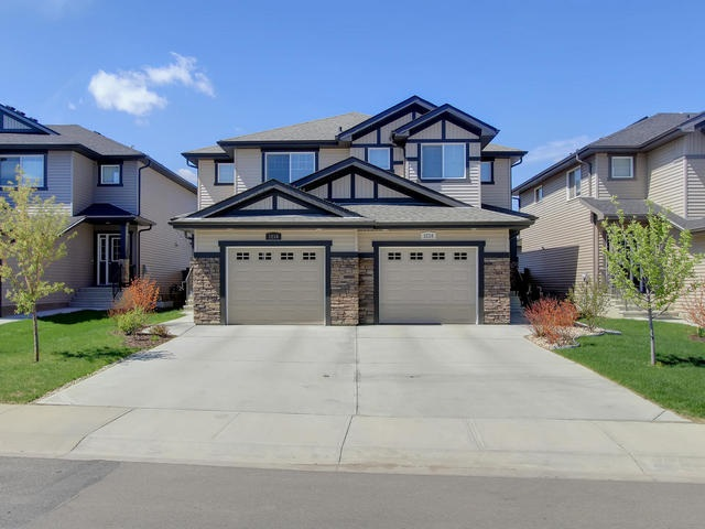Photo 1: 1218 177A Street in Edmonton: Zone 56 House Half Duplex for sale : MLS(r) # E4065067