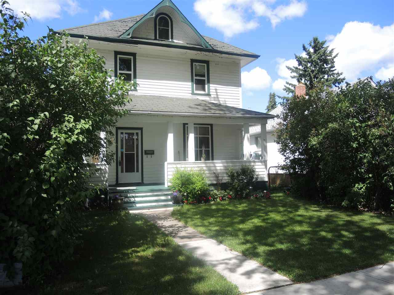 Character home in a fantastic location - 1 block from Millcreek Ravine, across from park and arena and curling rink