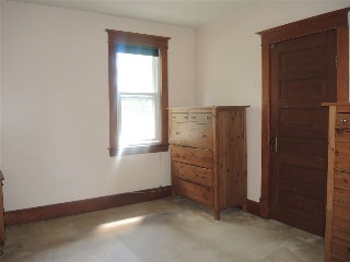Master bedroom with walk in closet and access to the attic which is ready to be developed