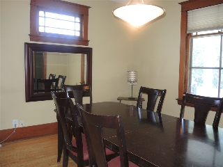 From the large entrance way, the dining room is to the right with the original hardwood and wood work, along with high ceilings, along with pocket doors to the living room. Take notice to the windows some appear to be original