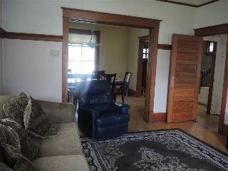 The living room originally was the dining room.  You will love the high ceilings, original hardwood and wood work.  Pocket doors between the living room and dining room.  Some windows have seen replacement, some of the windows appear to be original