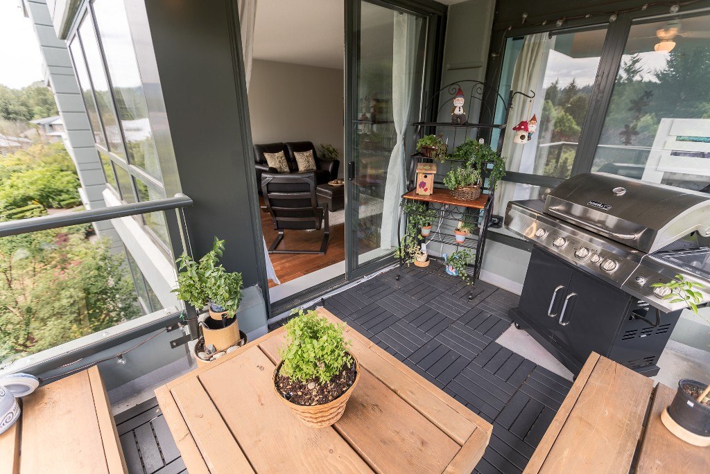 Great balcony with a sliding door to living room- Room for seating and a full size bbq!