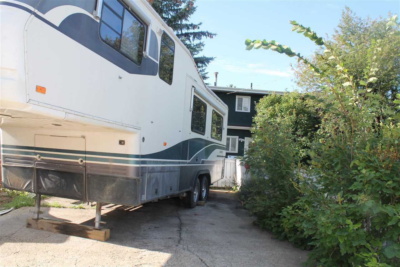 RV PARKING IN THE LARGE CEMENT PAD IN THE BACK OF THE HOME!
