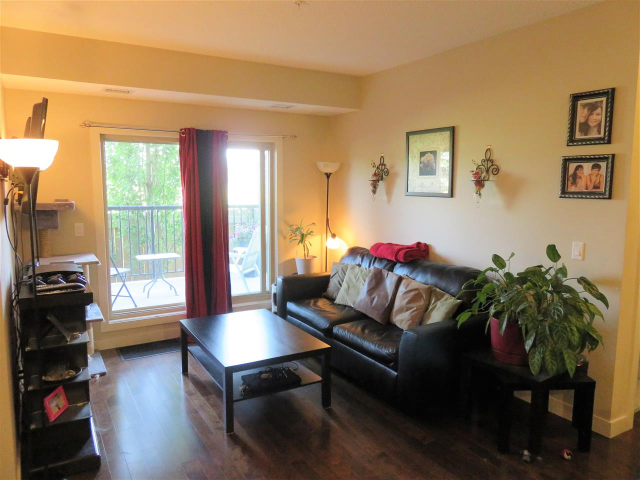View of the bright Living Room! Note the Hardwood & the warm paint colors too. :)