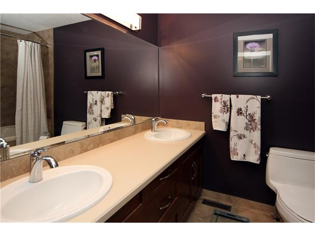 Master ensuite featuring dual sinks and heated floors