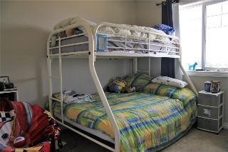Bedroom #3 - bright and spacious with a large closet to store your treasures