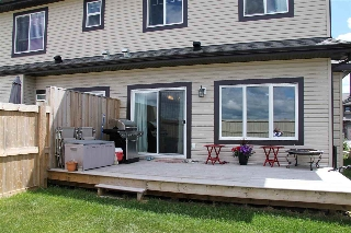 Step out from the nook to your large deck.  Enjoy your back yard and those BBQ's.  This is outdoor living at its best