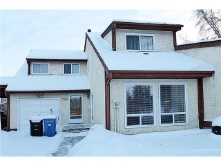 Main Photo: 1124 CANTERBURY Drive SW in Calgary: Canyon Meadows House for sale : MLS®# C4092925
