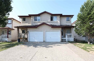 Main Photo: 9136 166 Avenue in Edmonton: Zone 28 House Half Duplex for sale : MLS(r) # E4073955